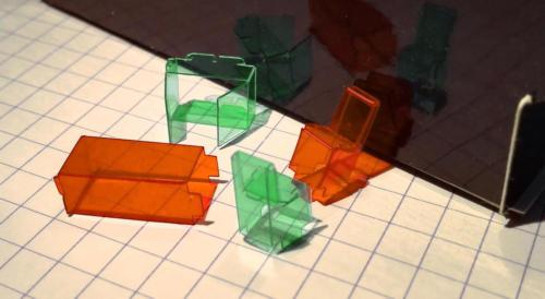 Tiny transparent foil objects